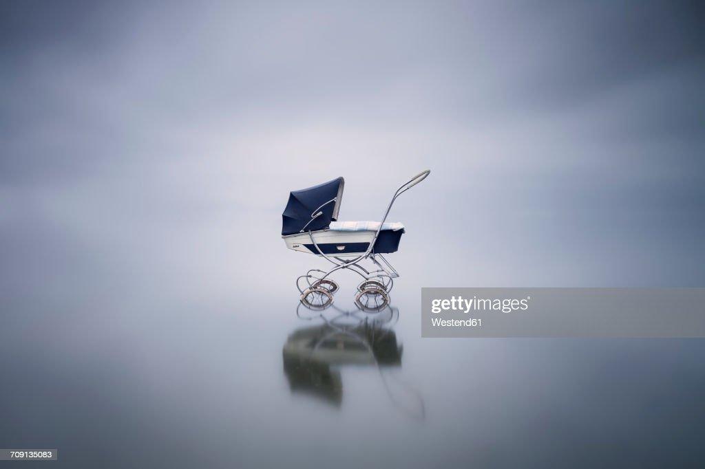 Stroller in a lake : Stock Photo