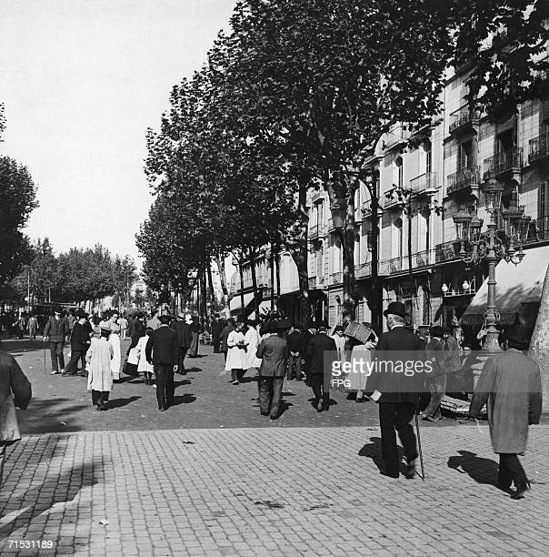 Strollers on Las Ramblas a busy street in Barcelona circa 1925
