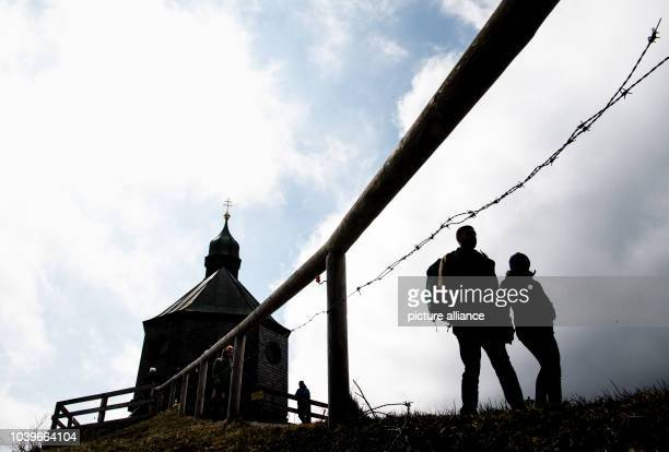 Strollers pass by the Wallbergkircherl on top of the Wallberg, near Rottach-Egern in the federal state of Bavaria, Germany, 14 April 2017. Photo:...