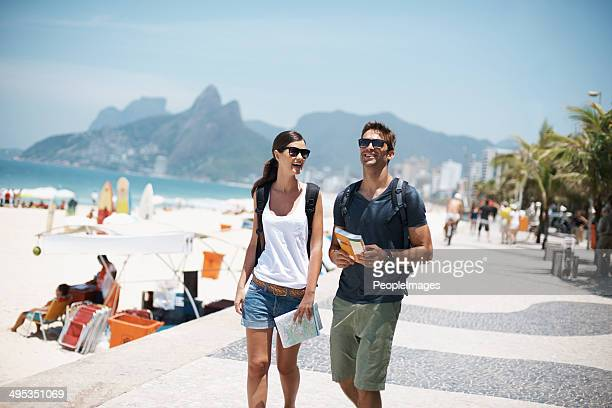 strolling along through paradise - brazilian men stock photos and pictures
