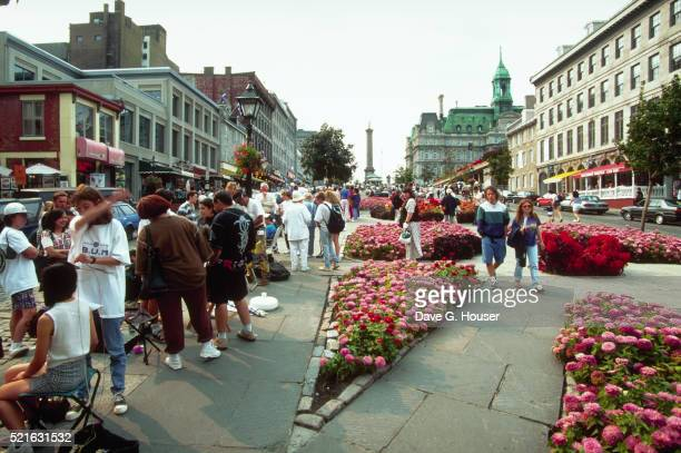 strolling in a montreal public square - place jacques cartier stock pictures, royalty-free photos & images