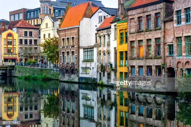strolling through the canals of ghent, ghent, belgium - belgium stock pictures, royalty-free photos & images