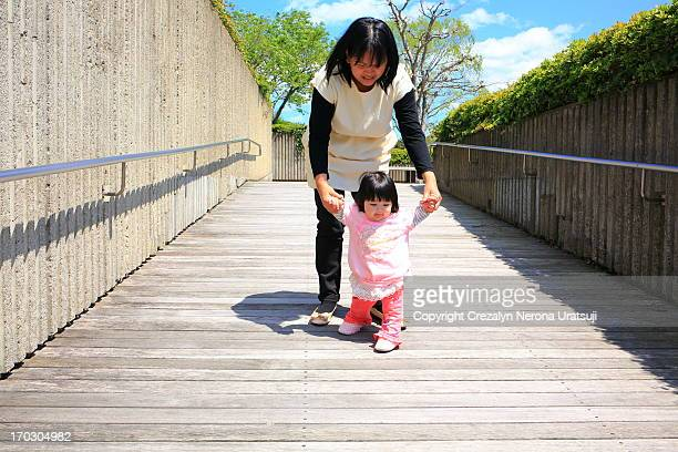 strolling with baby - bent over babes stock pictures, royalty-free photos & images
