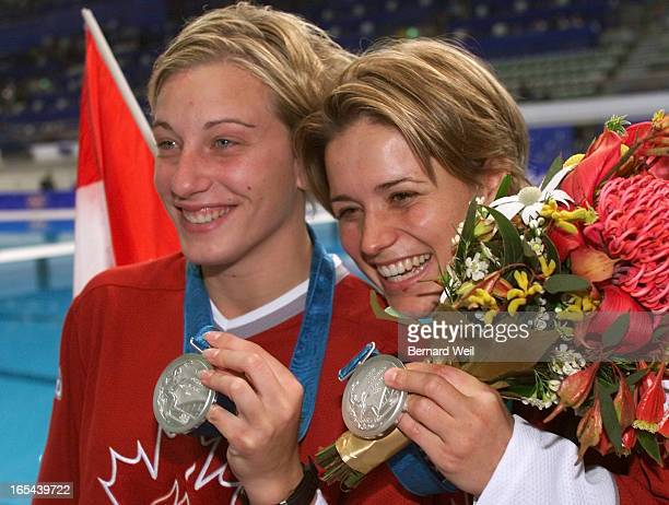 STROLYB1029/28/2000Emilie Heymans left and Anne Montminy display their silver medals after the Women's Synchronized 10m Platform Final competition...