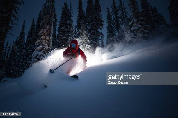 strom skiing in fresh powder. - winter sport stock pictures, royalty-free photos & images