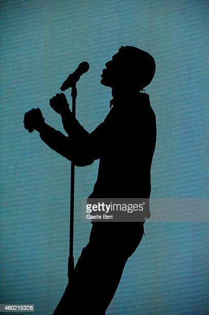 Stromae performs on stage at Eventim Apollo Hammersmith on December 9 2014 in London United Kingdom
