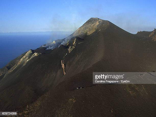 stromboli volcano by sea against sky - carolina fragapane stock pictures, royalty-free photos & images