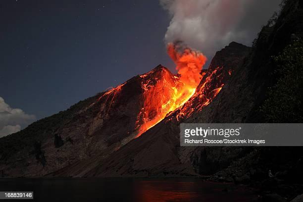 Strombolian type eruption of Batu Tara volcano, Indonesia.