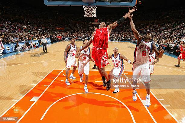 Stromile Swift of the Houston Rockets and Qyntel Woods of the New York Knicks battle for a rebound during a game at Madison Square Garden on February...