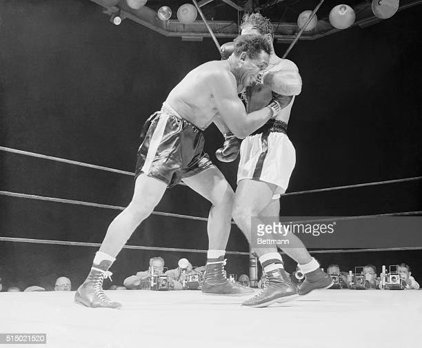Strong Arm Method New York New York Archie Moore gets Rocky Marciano's left arm in his face as the champ ends a blow to the challenger's head The...