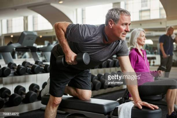 strong arms look good at any age - weight training stock pictures, royalty-free photos & images