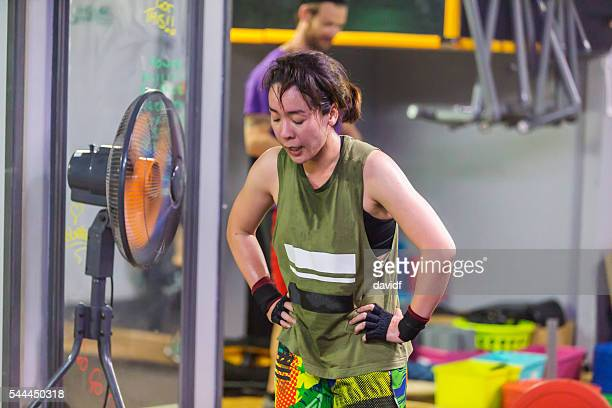 Strong Asian Woman Rests After Intense Cross Training Circuit Workout