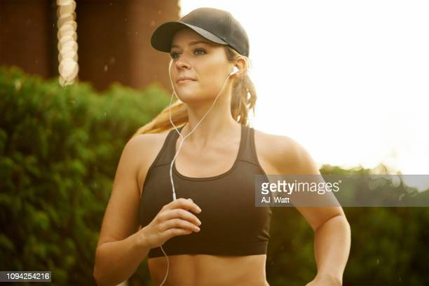 strong bodies are built through strong mindsets - sports bra stock pictures, royalty-free photos & images