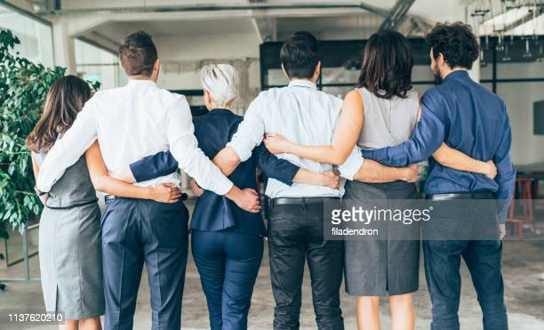 strong business team - arm around stock pictures, royalty-free photos & images