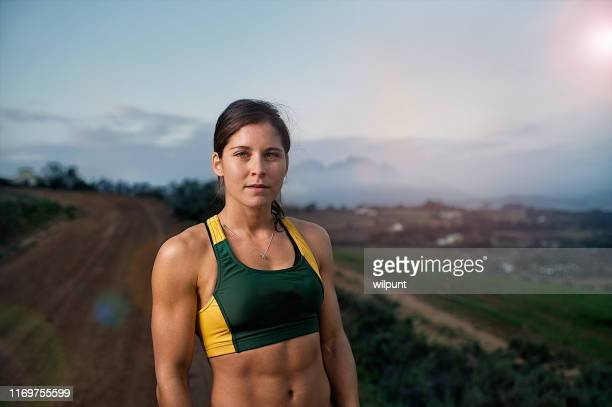 strong female athlete runner portrait - athlete stock pictures, royalty-free photos & images