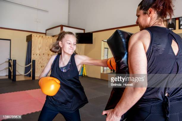 strong female martial arts athletes in their dojo training - showus stock pictures, royalty-free photos & images