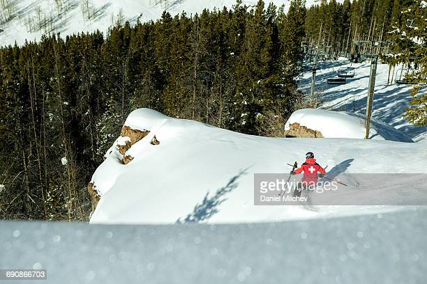 Strong female ski patrol skiing difficult terrain.