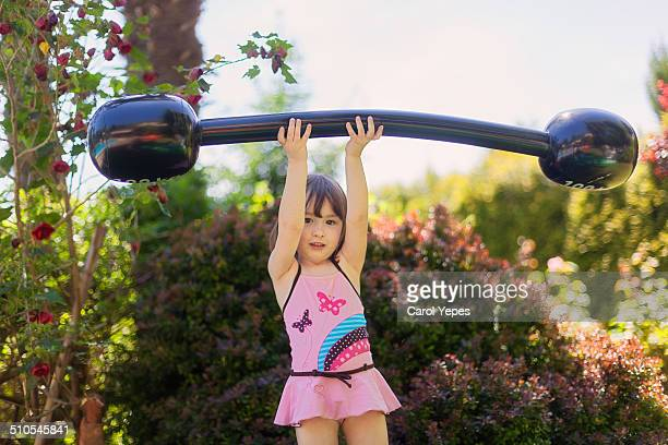 Strong girl lifting heavy barbell
