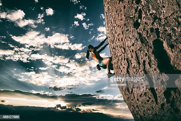 Strong girl rock climbing
