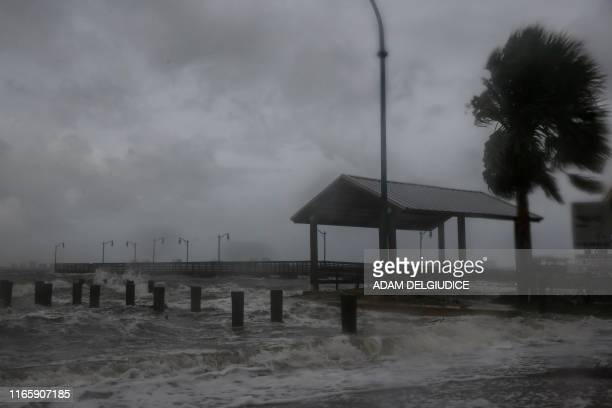 TOPSHOT Strong gusts of wind and bands of heavy rain cover a pier at the Jensen Beach Causeway Park in Jensen Beach Florida on September 3 2019...