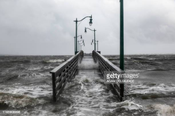 TOPSHOT Strong gusts of wind and bands of heavy rain cover a walkway at the Jensen Beach Causeway Park in Jensen Beach Florida on September 3 2019...