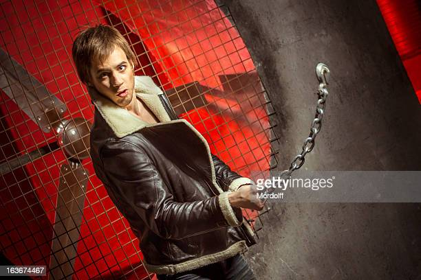 strong guy with metal chain - air raid shelter stock pictures, royalty-free photos & images
