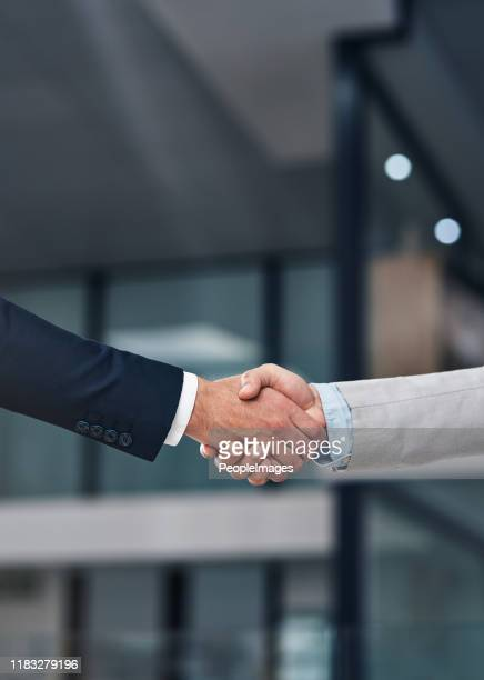 strong handshake for a strong partnership - outsourcing stock pictures, royalty-free photos & images