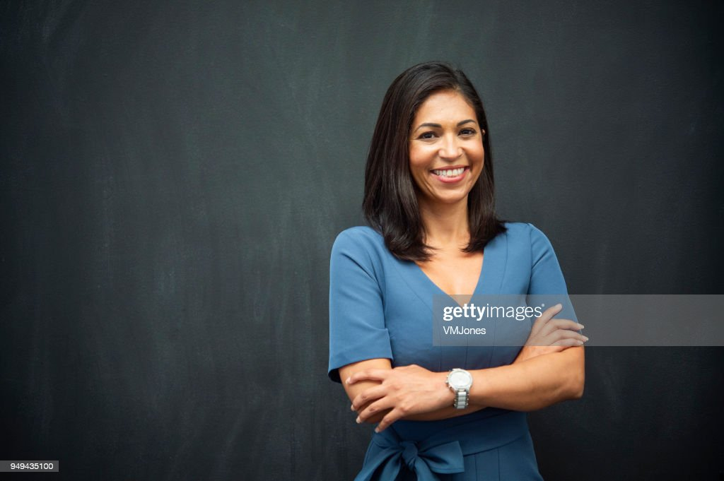 Strong Hispanic Woman Teacher : Stock Photo