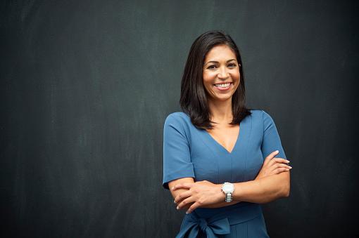 Strong Hispanic Woman Teacher 949435100
