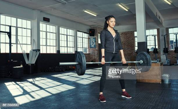 strong is what she aims for - women's weightlifting stock pictures, royalty-free photos & images