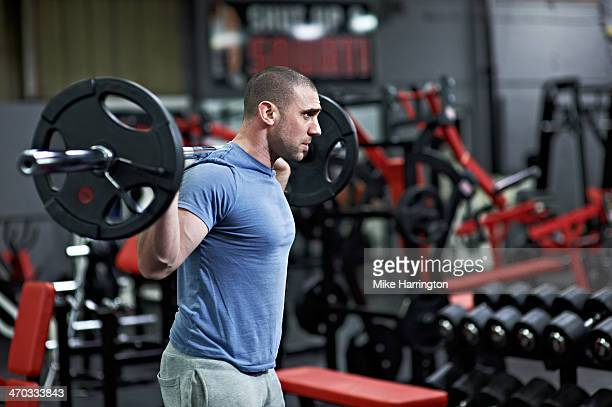 Strong Male Preparing to Lift Barbell