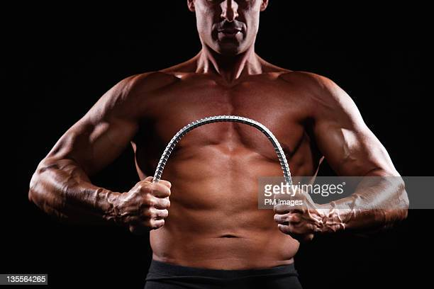 Strong man bending steel bar