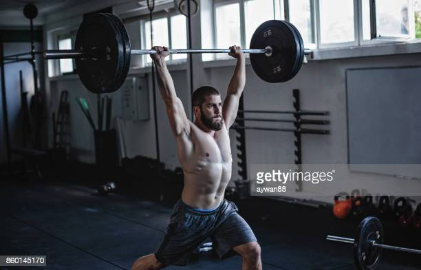 strong man exercising in gym - snatch weightlifting stock photos and pictures