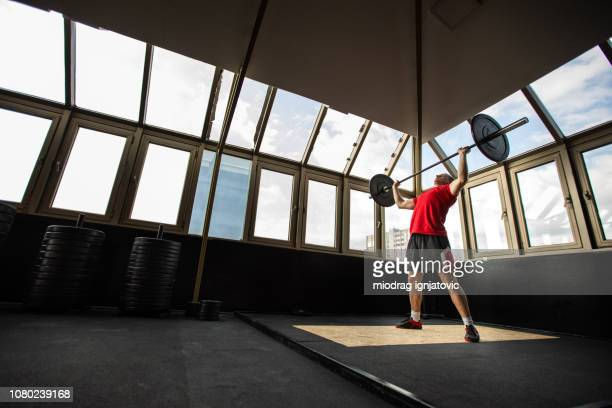 strong man in gym - snatch weightlifting stock photos and pictures