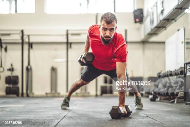 strong man is doing cross training exercise - weight training stock pictures, royalty-free photos & images