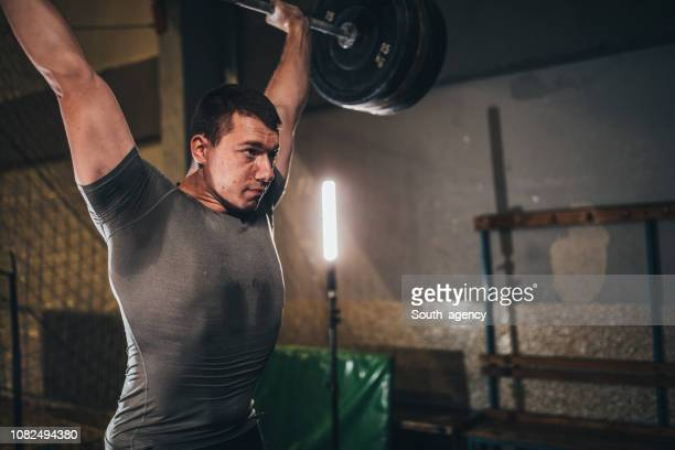 strong man - snatch weightlifting stock photos and pictures