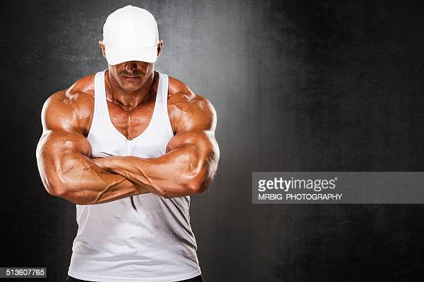 strong man - bodybuilding stockfoto's en -beelden