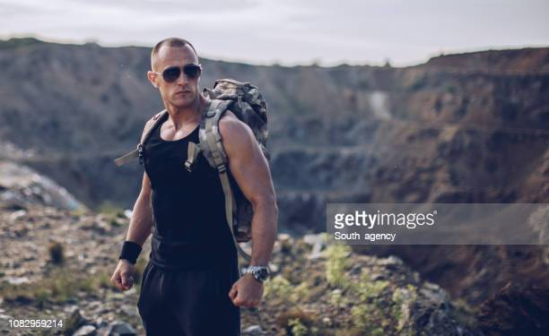 strong man standing on the cliff - masculinity stock pictures, royalty-free photos & images