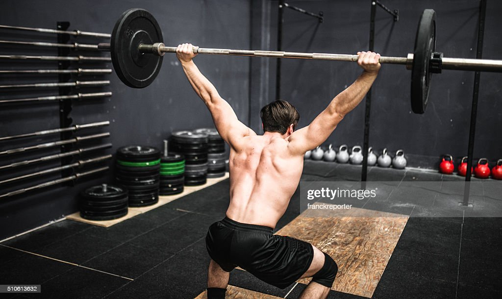 strong man weightlifting a barbell : Stock Photo