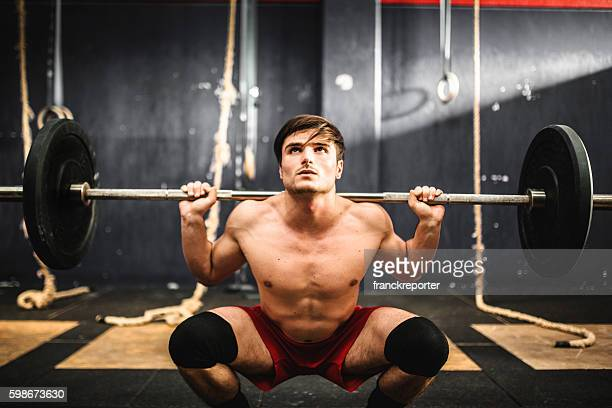 strong man weightlifting a barbell - snatch weightlifting stock photos and pictures