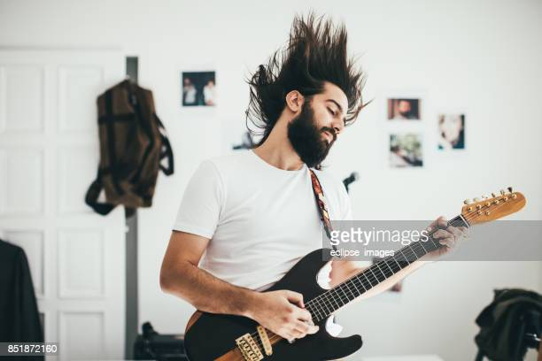 Strong man with guitar