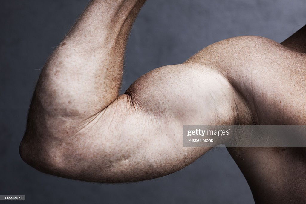 Strong man's arm : Stock Photo