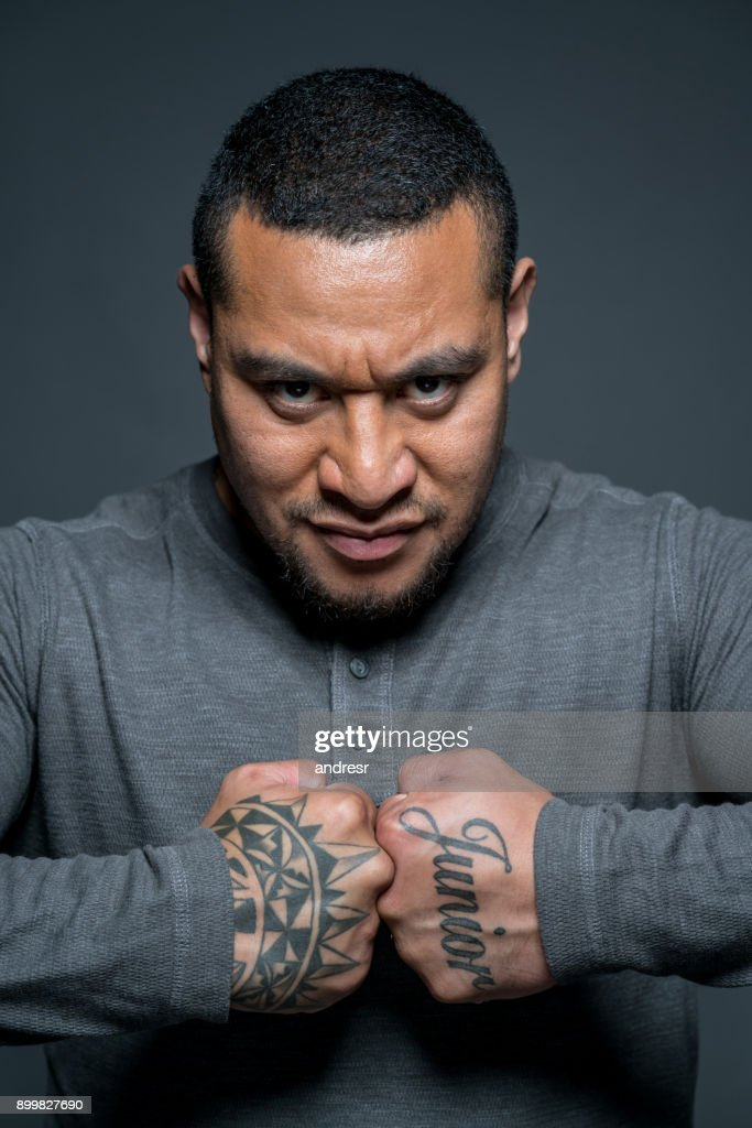 Maori Man: Strong Maori Man Showing His Tattoos High-Res Stock Photo
