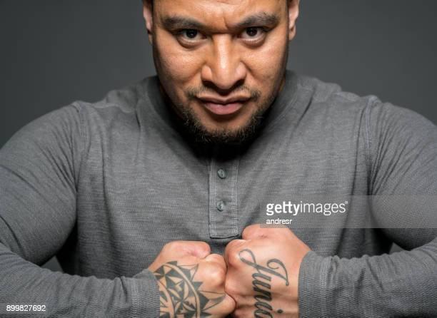 Strong Maori man showing his tattoos