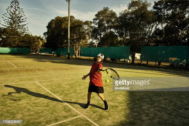 strong on the forehand and backhand - tennis racquet stock pictures, royalty-free photos & images