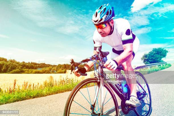 Strong performance by cyclist riding professional racing bike