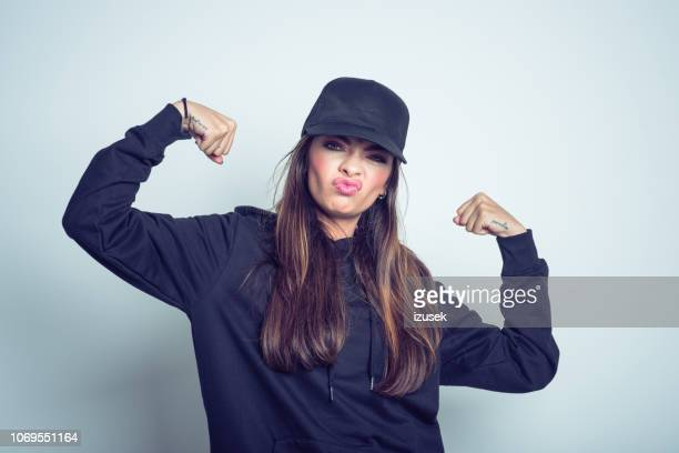 strong rebel young woman - cap stock pictures, royalty-free photos & images