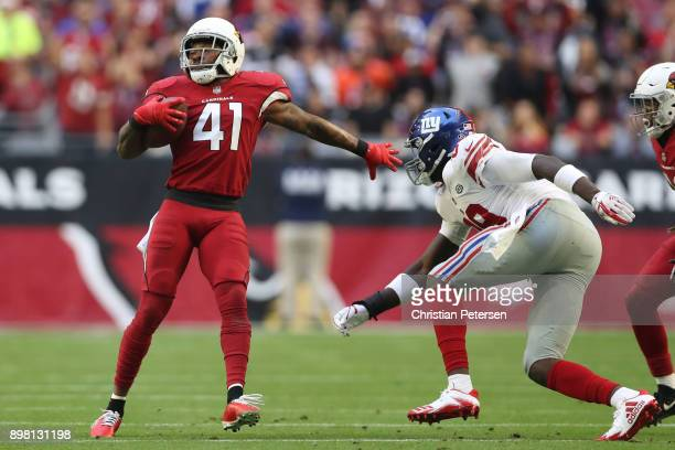 Strong safety Antoine Bethea of the Arizona Cardinals runs with the football after an interception against the New York Giants in the first half at...
