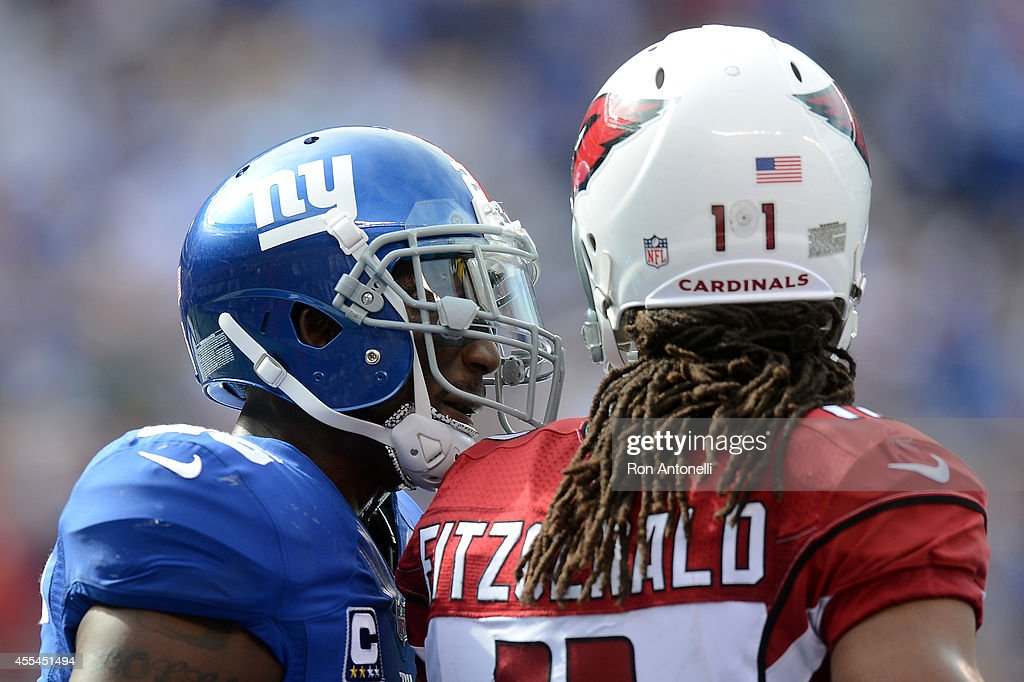 Strong safety Antrel Rolle #26 of the New York Giants has words with wide receiver Larry Fitzgerald #11 of the Arizona Cardinals during a game at MetLife Stadium on September 14, 2014 in East Rutherford, New Jersey.
