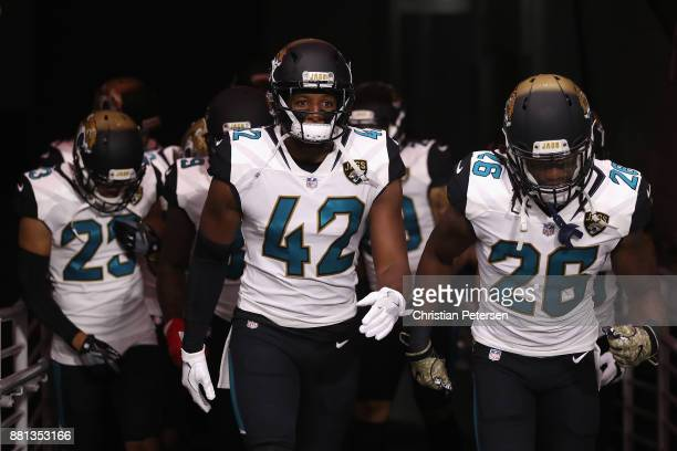 Strong safety Barry Church of the Jacksonville Jaguars leads teammates onto the field before the NFL game against the Arizona Cardinals at the...